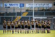 11 October 2015; The Mountbellew/Moylough team face the Tricolour during the National Anthem. Galway County Senior Football Championship Final, Mountbellew/Moylough v Corofin. Tuam Stadium, Tuam, Co. Galway. Picture credit: Sam Barnes / SPORTSFILE