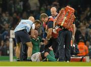 11 October 2015; Paul O'Connell, Ireland, sits back down on the pitch helped by Dr Eanna Falvey before being stretchered from the pitch after picking up an injury. 2015 Rugby World Cup Pool D, Ireland v France. Millennium Stadium, Cardiff, Wales. Picture credit: Matt Browne / SPORTSFILE
