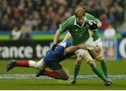14 February 2004; Paul O'Connell, Ireland, is tackled by Fabien Pelous, France. RBS 6 Nations Championship 2003-2004, France v Ireland, Stade de France, St. Denis, Paris, France. Picture credit; Matt Browne / SPORTSFILE *EDI*