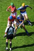 31 May 2009; Referee Barry Kelly throws the sliothar in between Cork's Tom Kenny and Jerry O'Connor and Tipperary's James Woodlock and Shane McGrath to get the game under way. Munster GAA Hurling Senior Championship Quarter-Final, Tipperary v Cork, Semple Stadium, Thurles, Co. Tipperary. Picture credit: Ray McManus / SPORTSFILE
