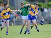 7 June 2009; Jason Stokes, Limerick, is tackled by Conor Whelan, 3, and Kevin Dilleen, 6, Clare. Munster GAA Football Senior Championship Semi-Final, Clare v Limerick, Cusack Park, Ennis, Co. Clare. Picture credit: Matt Browne / SPORTSFILE