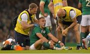 18 October 2015; Ian Madigan, Ireland, is attended to by Ireland team doctor Dr Eanna Falvey, right, and Ireland physiotherapist James Allen. 2015 Rugby World Cup Quarter-Final, Ireland v Argentina. Millennium Stadium, Cardiff, Wales. Picture credit: Matt Browne / SPORTSFILE