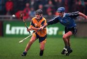 National Hurling League, Dublin V Clare, Parnell Park, 29/3/98. Clare's Alan Markham in a race for possession with Dublin's John Finnegan. Photograph © Ray McManus SPORTSFILE