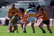 NFL Semi Final, Croke Park, Offaly V Donegal,12/4/98, Offaly Barry Malone is tackled by Jim McGuinness Donegal  . Photograph © Ray Lohan SPORTSFILE