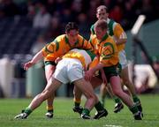 NFL Semi Final, Croke Park, Offaly V Donegal,12/4/98, Offaly full back Barry Malone is blocked by Donegal forwards Brendan Devenney, left and Brian Roper. Photograph © Ray McManus SPORTSFILE