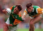 16/8/1997 Offaly v Meath Leinster Senior Football Championship Final Croke Park Dublin Action Features Meath's Brendan Reilly tackled by Offaly's Larry Carroll Picture Credit Ray McManus/SPOTRSFILE