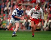 28th Sptember 1997: Brian McDonald Laois in action against Brendan Donnelly Tyrone, All Ireland Minor Final, Laois V Tyrone. Picture Credit: Ray McManus/SPORTSFILE.