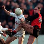 Down's Conor Deegan in a tussle for possession with Kildare's Brian Murphy during the   National League game in Newry. 14/12/97. Photograph David Maher SPORTSFILE.