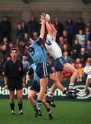 Monaghan's Cyril Ronaghan makes a clean catch from Dublin's Ciaran Whelan during   their NFL game at Parnell Park. 15/2/98. Photograph: Brendan Moran SPORTSFILE.