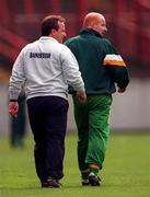 NFL Semi Final, Croke Park, Offaly V Donegal,12/4/98, Offaly and Donegal managers ,  Tommy Lyons and Declan Bonner walk the sideline . Photograph © Ray McManus SPORTSFILE