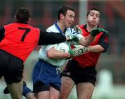 Church & General National Football League Quarter Final Down v Monaghan 5/4/1998 Declan Smith (Monaghan) is tackled by No7 Sean Ward and Malachy McMurray (Down)   Photograph Ray McManus SPORTSFILE.