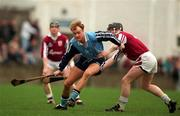 National Hurling League Division 1A, Dublin v Galway, Parnell Park. 8/3/98. Dublin's Derek McMullen holds off the challenge of Galway's Eugene Cloonan. Photograph © Brendan Moran SPORTSFILE.