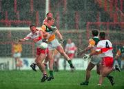National Football League Final, Derry v Offaly, Croke Park. 26/4/98. Action features left to right, Derry pair Fergal McCusker and Dermot Dougan with Offaly's Ronan Mooney, ( Right are Colm Quinn, Offaly and Johnny McBride, Derry)   Photograph © Ray McManus SPORTSFILE.