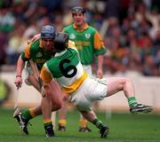 24 May1998. Meath's Fergus McMahon is tackled by Offaly's Brian Whelahan. Meath v Offaly, Leinster Hurling Championship, Croke Park. Picture Credit Ray McManus/SPORTSFILE