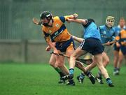 National Hurling League, Dublin V Clare, Parnell Park, 29/3/98. Clare's Frank Lohan holds of the challenge of Dublin's Barry O'Sullivan. Photograph © Ray McManus SPORTSFILE