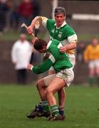 National Hurling League, Division 1A, Offaly v Limerick, Birr. 8/3/98. Offaly's Hubert Rigney is challenged by Limerick's Clement Smith. Photograph © Matt Browne SPORTSFILE.