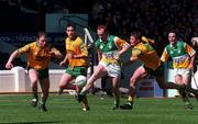 NFL Semi Final, Croke Park, Offaly V Donegal,12/4/98, Offaly James Stewart is tackled by Donegal No6 Martin Coll . Photograph © Ray Lowhan SPORTSFILE