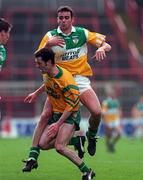 NFL Semi Final, Croke Park, Offaly V Donegal,12/4/98, Offaly James Grennan is tackled by Damian Diver Donegal  . Photograph © Ray Lohan SPORTSFILE