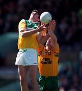NFL Semi Final, Croke Park, Offaly V Donegal,12/4/98, Action features James Grennan, Offaly and Donegal's Adrian Sweeney. Photograph © Ray McManus SPORTSFILE