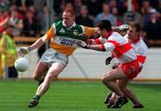 26 April 1998; James Stewart of Offaly in action against Fergal McCusker and Kieran McKeever of Derry during the Church & General National Football League Final match between Offaly and Derry at Croke Park in Dublin. Photo by Matt Browne/SPORTSFILE