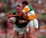 16/8/1997 Offaly v Meath Leinster Senior Football Championship Final Croke Park Dublin Action Features Meath's Jimmy McGuinness tackled by Offaly's Ciaran McManus Picture Credit Ray McManus/SPOTRSFILE