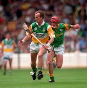24 May1998. Offaly's Joe Dooley gets away from Meath's Joey O'Loughlin. Meath v Offaly, Leinster Hurling Championship, Croke Park. Picture Credit Ray McManus/SPORTSFILE