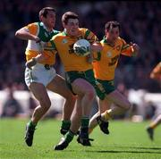 NFL Semi Final, Croke Park, Offaly V Donegal,12/4/98, Donegal's John Gildea is tackled from behind by Barry Malone. Photograph © Ray McManus SPORTSFILE