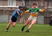 National Hurling League, Dublin v Offaly, Parnell Park, 19/4/98. Offaly's Michael Duignan holds off the challenge of Dublin's Paddy Brady. Photograph © Ray McManus SPORTSFILE.