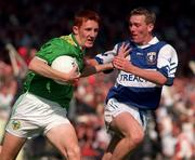 15.9.1996. Action Features Kerry's Noel Kennelly tackled by Laois Martin Delaney Kerry v Laois All Ireland Minor Final Croke Park, Dublin. Picture Credit Dave Maher/SPORTSFILE.