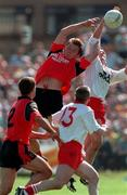 17th May 1998.  Action features Tyrone's Brian Dooher in action against Down's Paul Higgins as Finbar caulfield (No 2 Down) and Ciaran Loughran (No 13 Turone) look on.  Ulster Football Championship, Healy Park, Omagh, Co Tyrone.  Picture Credit. David Maher/SPORTSFILE.