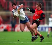 National Football League Quarter Final, Down v Monaghan, Croke Park, 5/4/98. Monaghan's Pauric McShane gets past the challenge of Down's James McCartan. Photograph © Ray McManus SPORTSFILE.
