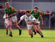 All-Ireland Club Championship semi-final replay, Sarsfields v Dunloy, Mullingar. 28/2/98. Sarsfields' Peter Kelly under pressure from Dunloy's Sean Mullan. Photograph © Ray McManus SPORTSFILE.