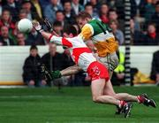 26 April 1998; Ronan Mooney of Offaly in action against Fergal McCusker of Derry during the Church & General National Football League Final match between Offaly and Derry at Croke Park in Dublin. Photo by Matt Browne/SPORTSFILE