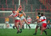 26 April 1998; Fergal McCusker and Dermot Dougan of Derry in action against Ronan Mooney of Offaly during the Church & General National Football League Final match between Offaly and Derry at Croke park in Dublin. Photo by Ray McManus/SPORTSFILE