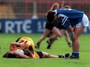 12/10/1997, All Ireland Ladies Football Final, Monaghan v Waterford, Monaghan Captain Angela Larkin and top scorer Edel Byrne celebrate Monaghan victory while Sarah Hickey of Waterford shows the disappointment of loseing. Photograph: Matt Browne/SPORTSFILE