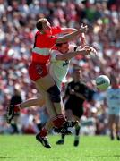 29th June 1997. Seamus Downey Derry in action against Chris Lawn Tyrone, Ulster Football Championship Semi Final, Clones. Picture Credit: David Maher/SPORTSFILE