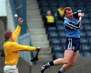 National Hurling League, Parnell Park, Dublin V Offaly 19/4/98. Shane Dalton, Dublin beats Stephen Byrne the Offaly goalkeeper, but the goal was disallowed by the referee. Photograph Ray McManus, SPORTSFILE