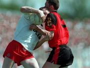 17th May 1998.  Action features Tyrone's Stephen Lawn being held up by Down's Simon Poland.  Ulster Football Championship, Healy Park, Omagh, Co Tyrone.  Picture Credit. David Maher/SPORTSFILE.