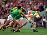 24 May1998. Offaly's Vinny Claffey gets away from Meath's Nigel Nestor (8), Mark O'Reilly and Trevor Giles. Meath v Offaly, Leinster Football Championship, Croke Park. Picture Credit Ray McManus/SPORTSFILE