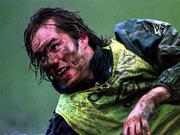 February 1996; Rep of Ireland's Jason McAteer gets covered in muck during a training session in Ivor Park, Pontyclun, South Wales. Soccer. Picture credit; David Maher/SPORTSFILE