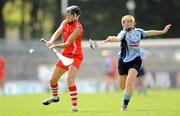 20 June 2009; Gemma O'Connor, Cork, in action against Laura Twomey, Dublin. Gala Senior Camogie Championship, Group 1, Round 1, Cork v Dublin, Pairc Ui Rinn, Cork. Picture credit: Paul Mohan / SPORTSFILE
