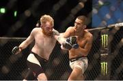24 October 2015; Paddy Holohan, left, in action against Louis Smolka. UFC Fight Night, Patrick Holohan v Louis Smolka. 3Arena, Dublin. Picture credit: Stephen McCarthy / SPORTSFILE