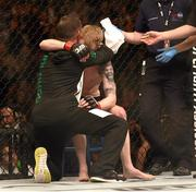 24 October 2015; Paddy Holohan is consoled after being defeated by Louis Smolka. UFC Fight Night, Patrick Holohan v Louis Smolka. 3Arena, Dublin. Picture credit: Stephen McCarthy / SPORTSFILE