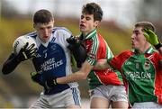 25 October 2015; Conor Diskin, Claremorris, in action against Matthew Rouse and Brian Peoples, right, Ballina Stephenites. JJ Burke Renault Minor A Football Championship Final, Claremorris v Ballina Stephenites. Elverys MacHale Park, Castlebar, Co. Mayo. Picture credit: David Maher / SPORTSFILE