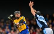 25 October 2015; Niall Gilligan, Sixmilebridge, scores a point despite the efforts of Cathal King, Na Piarsaigh. AIB Munster GAA Senior Club Hurling Championship, Sixmilebridge v Na Piarsaigh. O'Garney Park, Sixmilebridge, Co. Clare. Picture credit: Piaras Ó Mídheach / SPORTSFILE