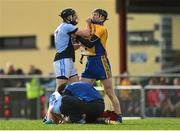 25 October 2015; Cathal King, Na Piarsaigh, and Niall Gilligan, Sixmilebridge, tussle as Na Piarsaigh's Ronan Lynch, Na Piarsaigh, receives treatment for an injury. AIB Munster GAA Senior Club Hurling Championship, Sixmilebridge v Na Piarsaigh. O'Garney Park, Sixmilebridge, Co. Clare. Picture credit: Piaras Ó Mídheach / SPORTSFILE