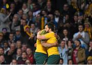 25 October 2015; Australia's Adam Ashley-Cooper celebrates with team-mate Israel Folau after scoring his side's first try of the game. 2015 Rugby World Cup, Semi-Final, Argentina v Australia. Twickenham Stadium, Twickenham, London, England. Picture credit: Ramsey Cardy / SPORTSFILE