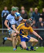 25 October 2015; Jamie Shanahan, Sixmilebridge, supported by team-mate Niall Gilligan, behind, in action against Mike Foley and Ronan Lynch, Na Piarsaigh. AIB Munster GAA Senior Club Hurling Championship, Sixmilebridge v Na Piarsaigh. O'Garney Park, Sixmilebridge, Co. Clare. Picture credit: Piaras Ó Mídheach / SPORTSFILE