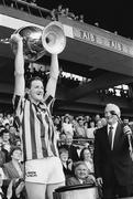 21 July 1991; Kilkenny captain Christy Heffernan lifts the Bob O'Keeffe cup in the company of Leinster Council Chairman Jimmy Grey. Leinster Senior Hurling Championship Final, Dublin v Kilkenny, Croke Park, Dublin. Picture credit; Connolly Collection / SPORTSFILE