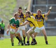 4 July 2009; Sean Ryan, Offaly, in action against Adrian Flynn, 12,  Aindreas Doyle and P.J. Banville, Wexford. GAA All-Ireland Senior Football Championship Qualifier, Round 1, Wexford v Offaly, Wexford Park, Wexford. Picture credit: Ray McManus / SPORTSFILE